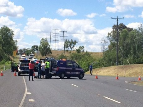 Paramedics treat a man who was tasered by police at the scene of a fatal traffic crash.