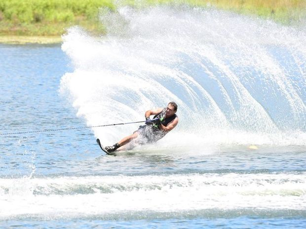 WATERSKIING: Mark Di Salvo powers round the turn at the Isis Ski Gardens annual Aussie Day Challenge. Photo: Paul Donaldson / NewsMail