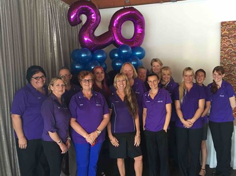 Harrmony House staff recently gathered to celebrate 20 years of operation.