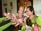 Karen Gibb thought she had lost her precious heirloom gold necklace, but was thrilled when Honest Thai Massage owner Yupan Thomas found it after Karen's visit. Karen bought flowers for Yupan to say thanks. Photo: Che Chapman / Sunshine Coast Daily