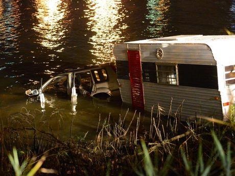 Car towing a caravan discoverd in the Fitzroy River. Photo Sharyn O'Neill / Morning Bulletin