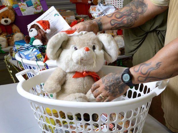 Prisoners John and Kevin from the Southern Queensland Correctional Centre help stock baskets full of goodies as part of the QT Adopt a Family Appeal.