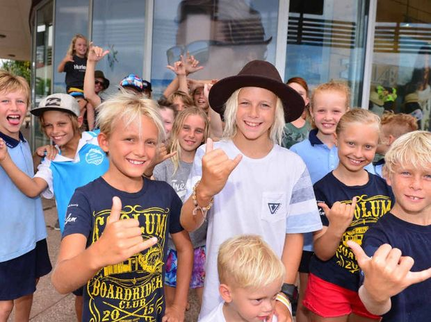 Coolum groms, led by young surfers Ashton Pignat and Zane Assink, cheer on their home town hero Julian Wilson ahead of his vital world tour showdown in Hawaii today.