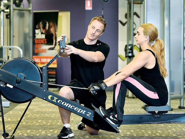 FITNESS FOR LIFE: Personal trainer Mark Amphlett works with client Thalia Esposito at Pialba's Anytime Fitness.