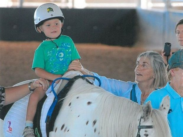 Kayden Kolm rides a horse provided by Bundaberg Riding for the Disabled. Photo: contributed