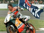 Australia's Mick Doohan celebrates his victory in the 500cc British Motorcycle Grand Prix at Donington Park, Leicestershire, August 17 1997, making him World Champion for the fourth year running. (AP Photo/Martin Cleaver)