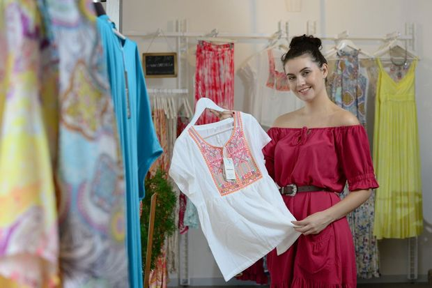 Yasmyn Paul of Whitehaven Emporium with dresses from her summer collection. Photo: David Nielsen / The Queensland Times