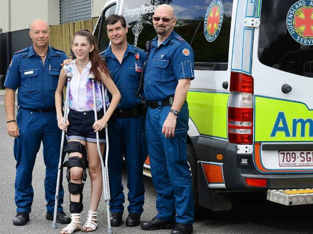 ON THE MEND: Accident survivor Colleen Tabone of Lowood thanks ambulance paramedics (from left), Peter Brown, Alex Henderson and Paul Beswick. INSET: Ms Tabone's car shortly after the crash.