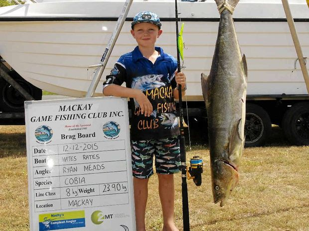 HAPPY: Ryan Meads with the record-breaking cobia caught near Keswick Island.