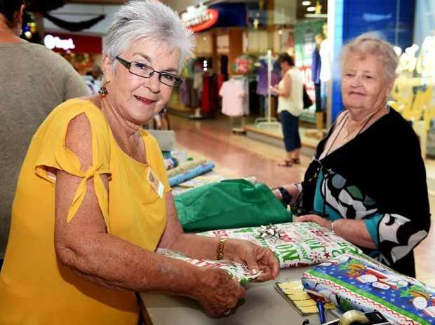 Jan Bruce was wrapping dozens of presents to raise funds for Hervey Bay Pet Warriors at Stockland in Hervey Bay.