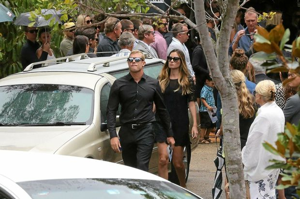 Former World number one and current number two ranked surfer Mick Fanning with wife Karissa Dalton, leaving older brother Peter's funeral service at Tweed Heads Memorial Gardens on Tuesday morning.