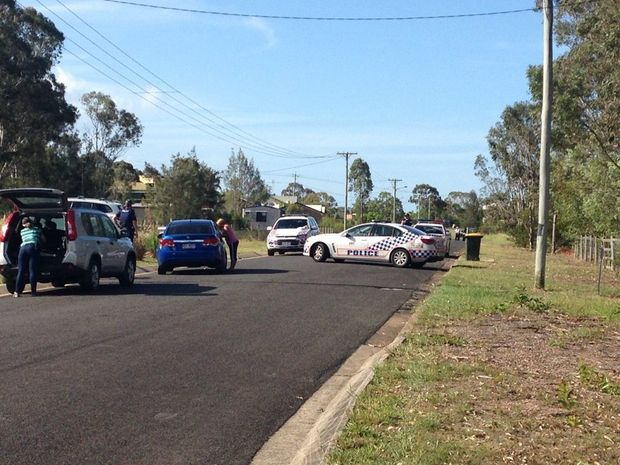 ON SITE: Police negotiators have arrived at the scene of a home siege on Kingfisher Drive in River Heads. Police officers have blocked off part of the road from the public.
