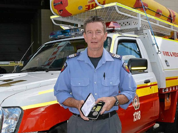 MEDAL HONOURS: Warwick senior firefighter Michael Coombes received the Humanitarian Overseas Service Medal for his work in Christchurch.