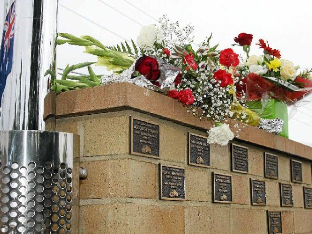 MEMORIAL: Flower tributes line the wall of remembrance at South Grafton. This year's memorial will be held on March 19.