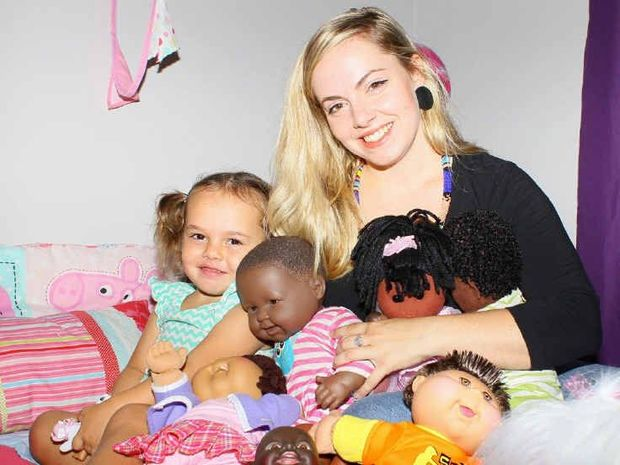 BREAKING STEREOTYPES: Danielle Vujovich, pictured with her daughter Charlie, has been buying dolls of all ethnicities for her children to ensure they have a diverse appreciation of beauty.