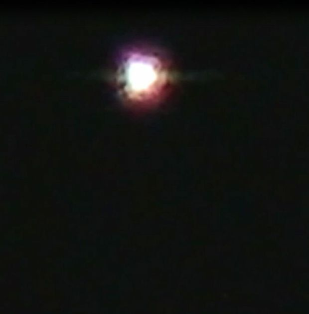 A still from a video taken by a Bundaberg resident showing an apparent UFO in the night sky. Gympie residents are being asked to log their sightings.