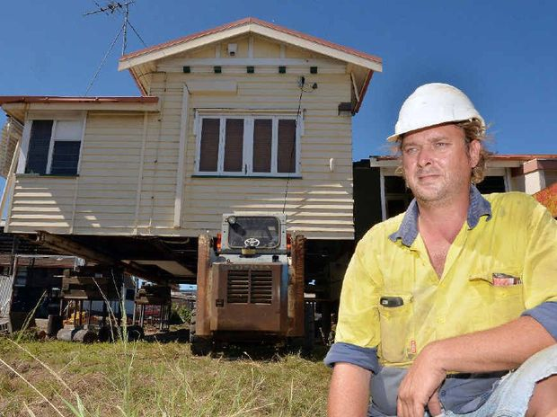 PAUSED: Luke Lammi, son of Ken Lammi, is in Mackay to move a Queenslander to a temporary site before it's relocated to a permanent site at Kuttabul, but his efforts have been put on hold.