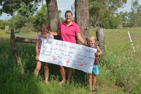 Lissy Gatera with Bo and Toby and the famous sign. Photo Andrew Messenger / Big Rigs
