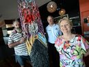LOCAL artist Tim McGrath has donated three carved surfboards to Busi Women Inc