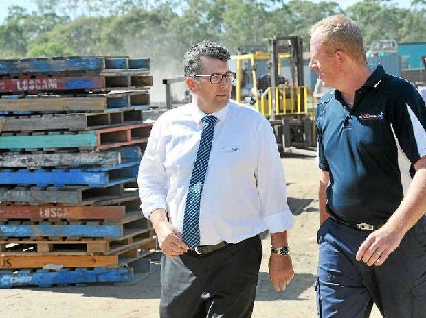 FAIR GO: Member for Hinkler Keith Pitt talks is calling for fair rules for small businesses pictured with Bundaberg Sandblasting owner Wayne Edwards (file photo).