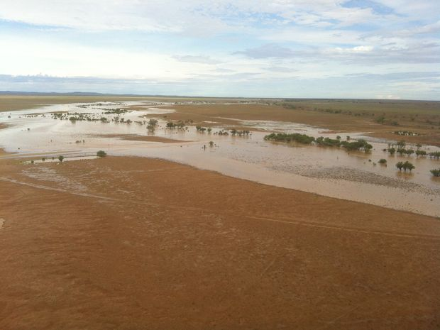 An Ergon field crew worker took the attached photos from one of nine flights ferrying temporary poles by helicopter yesterday. This was over a creek in the Stonehenge area flooding a local road and surrounding paddocks.