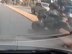 Dashcam vision of a collision between a car and trike.