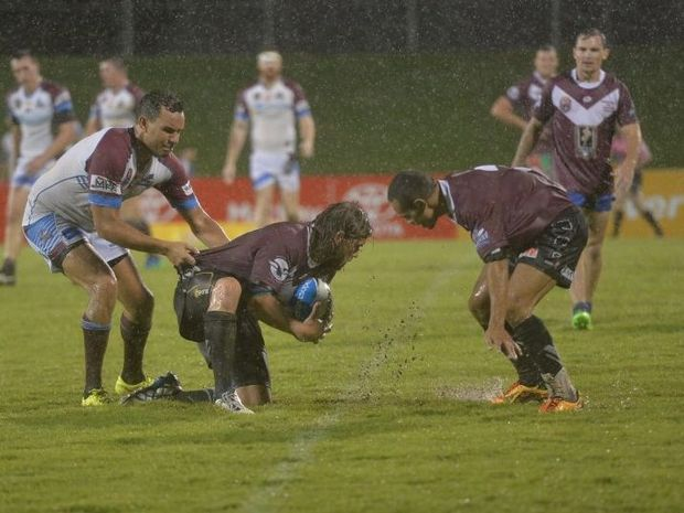 Dave Wilson gathers the ball in the wet conditions for the All Stars side. Photo Chris Lees / Daily Mercury