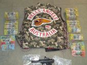 POLICE have charged a Hells Angels member and a woman after allegedly finding drugs, a semi-automatic handgun and $158,000 cash at a Surfers Paradise home.