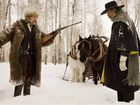 DELICIOUSLY DECEITFUL: Kurt Russell and Samuel L Jackson in a scene from the movie The Hateful Eight, the latest film from director Quentin Tarantino.