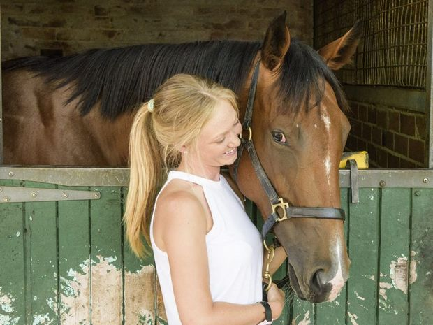 Charlee Bear, pictured with strapper Leah Kilner, is an odds-on favourite to win the opening race on the card at Coffs Harbour today.