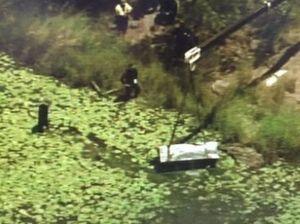Bodies found in metal box dumped in dam near Logan