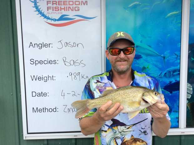 Jason caught this .989kg bass earlier this month. Photo Freedom Fishing Supplies / Fraser Coast Chronicle