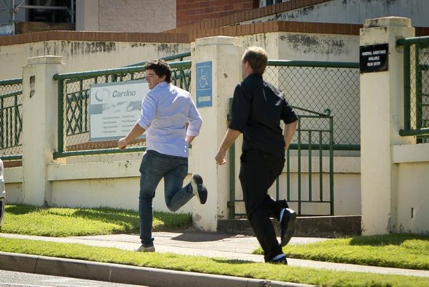 Brendan Clarke and Stephen Pugh run out of court to avoid a media cameraman. Photo Paul Braven / The Observer