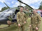 WELCOME EXPO: Defence personnel new to the Darling Downs ejoyed a welcome expo at Borneo Barracks. Greeting family members and explaining the workings of a Kiowa are Lt Leon Botham and Lt Jarrod James at the Kiowa training helicopter. Feb 20, 2016