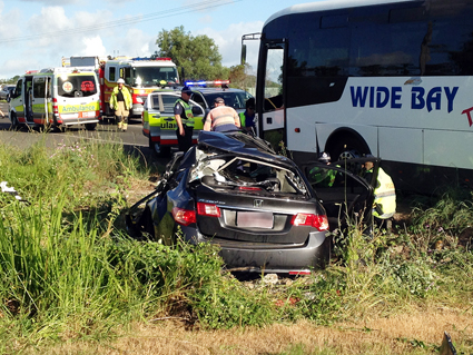 Queensland Fire and Rescue crews worked to free the child after a bus collided with a car on Pialba-Burrum Heads Rd.