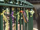 Sharon Poulton-Hackett has been attaching ribbons to St Patrick's Cathedral fence to support victims of child abuse.