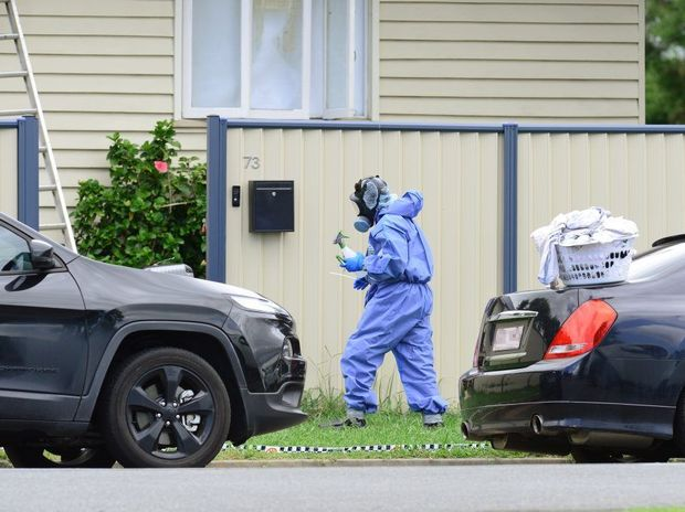 Police and forensic officers inspect a Booval property following a fatal shooting last week.