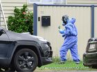 Police and forensic officers inspect a Booval property where a man was fatally shot. Photo: David Nielsen / The Queensland Times