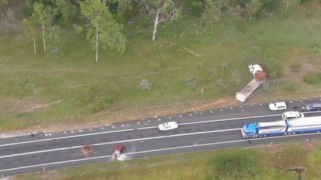 Three people in a suspected stolen car crashed into a truck on the Bruce Hwy this morning 13km south of Miriam Vale.