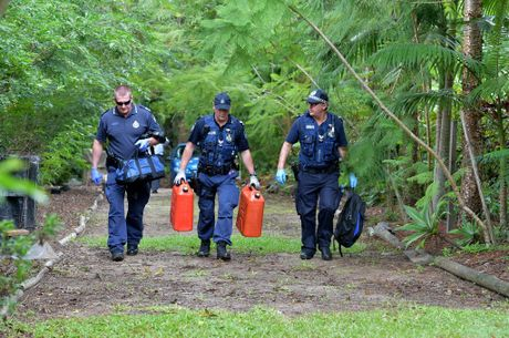 Police seize empty plastic fuel containers as well as bags from a Thompson Rd property while investigating a suspected arson at a nearby home in Strawberry Rd at Beerwah.