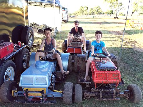 Allan Heggie with his dad Adam and little brother Jordan before the mower racing competition in Maryborough on the weekend.