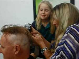 WATCH: Olivia Heckels shaves her dad's head.