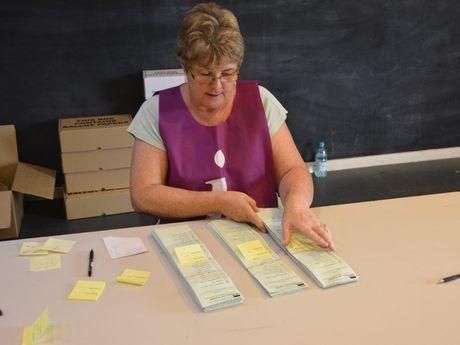 An ECQ official organising votes.