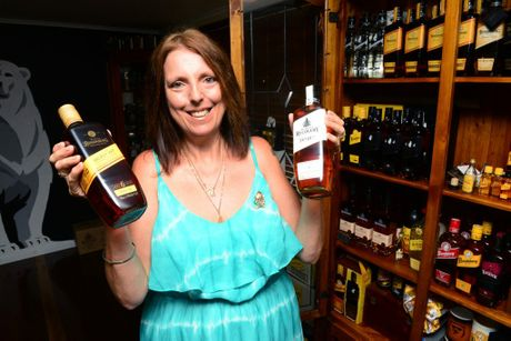 RUM FAN: South Kolan resident Michelle Kelly is an avid collector of Bundaberg Rum memorabilia. Photo: Max Fleet / NewsMail