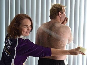 Maryborough's Russell Booth and partner Charmaine Bailey - Russell is getting his back waxed at Pubfest to raise money for charity. Photo: Alistair Brightman / Fraser Coast Chronicle