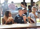 Barbecue at Torquay Beach put on by Queensland Police, PCYC, Galangool and the Torquay IGA for local kids. Acting Snr Cnst Leigh Nancarrow sits down for a snag with 17 yr old Shakeya Baker and 6 yr old Zavier Alaban.