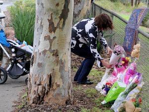 Vigil held for toddler as search for killer continues