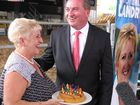 Capricornia MP Michelle Landry presents Nationals Leader and Acting PM Barnaby Joyce with a birthday cake in Rockhampton. Photo contributed.