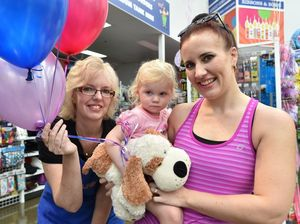 Spotlight staff member Kerrie Gomboc with Bella and mum Tara Birse and her toy puppy she was reunited with. Photo: Alistair Brightman / Fraser Coast Chronicle