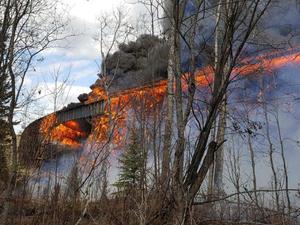 Wooden bridge destroyed in spectacular fire